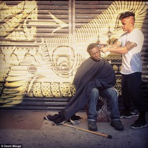 Mark Bustos cuts hair of a homeless New Yorker. (photo credit: Devin Masga)